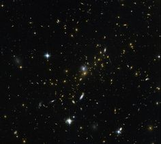 This image from the NASA/ESA Hubble Space Telescope reveals a galaxy cluster, known as MACS J0454.1-0300. Each of the bright spots seen here is a galaxy, and each is home to many millions, or even billions, of stars. [Read the Full Story Behind This Photo