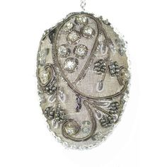 """3"""" Hand Beaded on silk dimensional egg can be hung on an Easter or Christmastree for an elegant hand crafted heirloom. Each piece comes with a cord for hanging."""