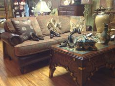 Brown leather couch with fabric cushions.