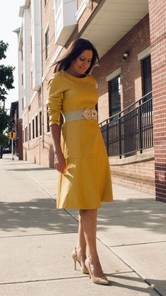 Most women focus their wardrobes around traditional, linear garments, resulting in a bland and uninspired appearance. However, how often do you see a long-sleeve yellow leather dress? It is already rare to see a black leather dress, so why not yellow? Yellow Leather Skirt, Black Leather Dresses, Faux Leather Skirt, Stylish Dresses, Nice Dresses, Wool Dress, We Wear, Dress First, Skirt Outfits
