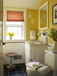 Yellow bathroom with sink skirt