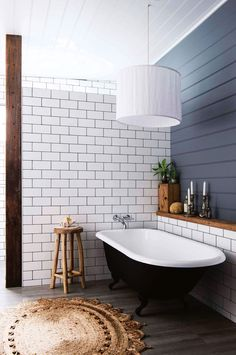 Unlike their sleek and shiny urban counterparts, country bathrooms feature hard-worn surfaces like rustic timber and aged brass over precious marble and natural stone. Be inspired to recreate the look at home with these 17 examples of modern country style Bathroom Bath, Bathroom Renos, Bathroom Interior, Home Interior, Bathtub Tile, Bathroom Things, Interior Walls, Wood Panel Bathroom, Bathtub Shelf