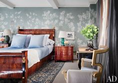 In Ali Wentworth and George Stephanopoulos's Manhattan apartment, which was designed by Michael S. Smith, the master suite is sheathed in hand-painted chinoiserie wallpaper by Gracie; the Italian neoclassical bed is dressed in Nancy Koltes linens.  DESIGNER: Michael S. Smith Inc. PHOTOGRAPHER: Scott Frances
