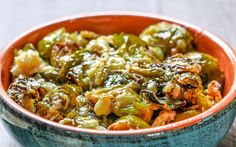 Oven-roasted Brussels sprouts are cooked with a creamy, cheesy sauce made from coconut milk and melty vegan cheese.