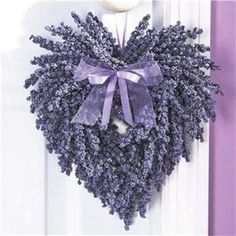 A purple twist on Valentine's Day....lilac heart wreath, pretty.