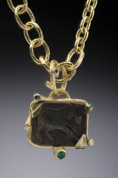 Bronze horse seal Pendant with blue, white diamonds and emerald set in 18K.  Hughes-Bosca Jewelry | Pendants & Brooches