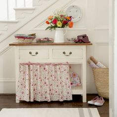 hide an open shelf with a curtain - these have ties that are really cute
