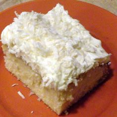 "Sometimes you just want a cake that is light, yet flavorful.  I was in such a mood recently and made this cake for my family, who loved it. We call it Coconut Cloud Cake as it is light and fluffy.  The blend of a classic white cake, infused with coconut and topped with a delicious whipped cream frosting and crowned with sweet coconut, how could it get any better?  This cake recipe is my ""go to"" white cake recipe that I use with a variety of toppings and icings.  I think you will find it easy…"