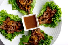 This version of the traditional Korean grilled barbecue beef dish is quickly cooked in a wok and served taco-style in lettuce leaves.