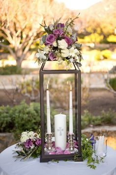 Unity Candles in a Glass Lantern are wonderful for an outdoor wedding. Here, the candles are protected from the wind. The candles symbolize the union of the wedded ones' circles of friends and family.