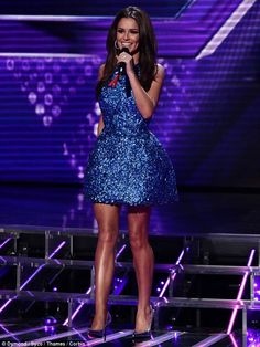 Blue beauty: Cheryl looked stunning in her Monique Lhuillier dress and Stuart Weitzman heels on the results show