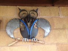 Owl sculpture made from a shovel and a saw blade and other pieces of scrap metal