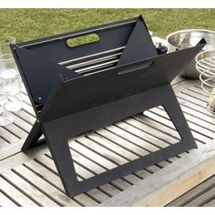 Fire up the charcoals and show off your cooking skills at the park or beach with the Notebook Portable Grill. The classic look of this Barbecue brings to. Clean Grill, Grilling, Diy Grill, Diy Outdoor Kitchen, Outdoor Cooking, Barbecue Garden, Portable Charcoal Grill, Small Gardens, Wedding Centerpieces
