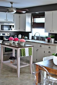 white cabinets with dark walls