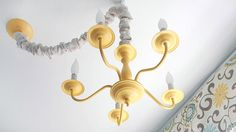 yellow chandelier hanging from ceiling - How to paint a brass chandelier, from @prettyhandygirl