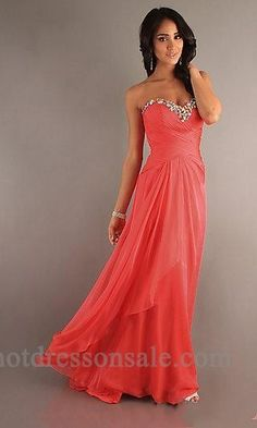 PROM DRESS Physical Representation: 1. Fabric- light flowing chiffon 2. Beading- crystal embellishment on the bodice 3. Structure- cossetted top and flowing drapery 4. Color- striking coral 5. Built for an hour glass shape to accentuate the waist