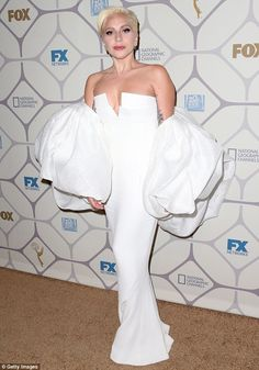 White lady: Gaga showed up to the Fox post-Emmys party in a sheath gown with a daring neckline and very large puff sleeves