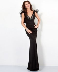 Long black evening dress with tulle flutter sleeves & rhinestone details from Jovani (Style: 5402).