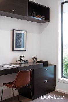Laminate desk and shelving in Natural Oak Matt. Melamine worktop in Strata Grey Matt.