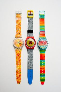 Please bring back the Swatch Watch! Mine had a black band, mirror face, and glow-in-the-dak hands.