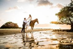 Lombok prewedding with horse at the beach by Bali Pixtura - Bali Wedding Photographer