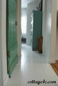 FLOOR – Painted White Wood Floors; door is pop of color- replace sliding bathroom door