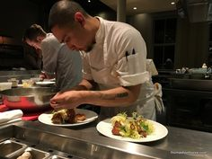 Photo of a sous chef plating food at The Commissary San Francisco