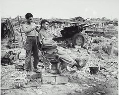 American soldiers using a Japanese barbers chair - 1945
