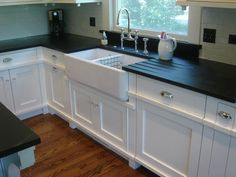 I'm seriously feeling soapstone counters with a big beautiful farmhouse sink.