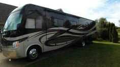 """2012 Used Thor Motor Coach Challenger DT Class A in Michigan MI.Recreational Vehicle, rv, Original MSRP $149,183.00 New 2012 Thor Motor Coach Challenger Model 37DT. This Beautiful spacious luxury Coach has never been smoked in and is in pristine condition! measures approximately 38 feet and features (3) slide-out rooms. The DT floor plan is highlighted by the extendable L-Shaped sofa & fireplace in the living room with 32"""" HiDef TV, the U-shaped booth dinette and the Rear Queen Bed w/plenty…"""