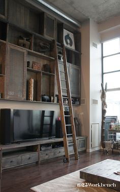 We made a 16' high built-in unit with custom rolling ladder and library ladder hardware for a loft.