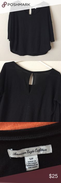 Black quarter sleeve top. American Eagle Black with open hole back top. From American Eagle, in great condition. Super soft and a great go to for any season! American Eagle Outfitters Tops