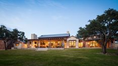 This Austin ranch house epitomizes rustic style indoors and out. Interconnected barn-like structures house the main living areas, which feature wood and other natural textures, a neutral palette, exposed beams and high ceilings throughout.