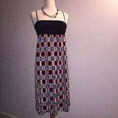 ⭐️ BOGO! Max Studio Empire Waist Swing Dress ⭐️ BOGO! Max Studio Multicolor Tube Dress with spaghetti straps. Simple dress can be worn casual or dressed up. Comfortable. Size is XS, believe it could fit from a size 2 to 6. Worn a few times.  *** Eligible for Buy One, Get One 50% off! Item must be of equal or less value. *** Max Studio Dresses