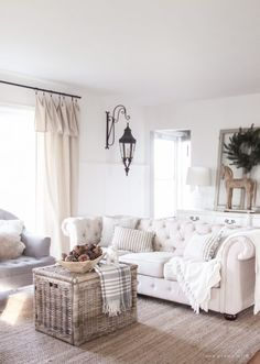 A beautiful farmhouse living room decorated for the holidays!