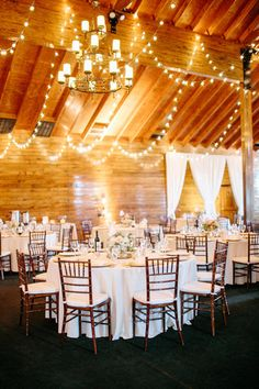 The hanging lights and white table cloths created a magical atmosphere! {Sera Petras Photography}
