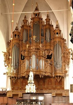 Extremely elaborate, highly carved organ in a church in Lubeck, Germany, maybe St. Giles?