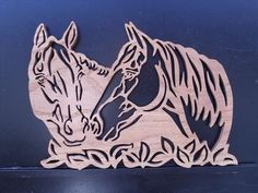 Beautiful fretwork design of a pair of Horses