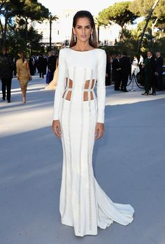 Formal Dress Inspiration | What All the Celebs Wore to the 2016 amfAR Gala | Izabel Goulart in a long sleeve white dress with midriff cutouts