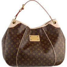 Louis Vuitton - I love how much I can fit in this bag. Very tradition and it goes with anything