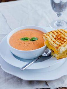 Roasted tomatoes in a cream of tomato soup served alongside the cheesiest 3 cheese grilled cheese sandwich