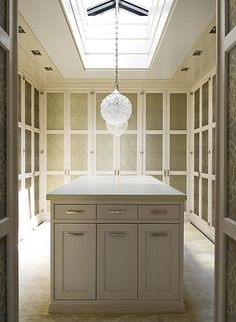Beautiful dressing room architecture w/ pendants suspended from soffit skylight; Steven Gambrel