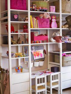 Floor-to-ceiling shelving provides plenty of storage for children's toys.