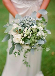 Elegant Bridal Bouquet Featuring Dusty Blue Hydrangea, White Roses, White Stock, Queen Anne's Lace, Star Of Bethlehem, Green Poppy Pods, Green Eucalyptus & Other Foliage