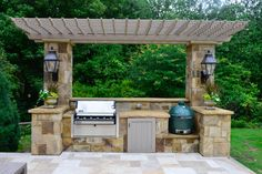 A Weber grill and Big Green Egg - a ceramic cooker - are key components of the outdoor kitchen. Amenities such as an icemaker also make it easy to pull parties over to the pool house.