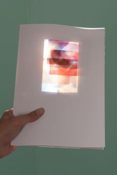 The photos are experimenting with light, blur and perspectives, creating sheer images of undefined forms and colors resulting in a collection of sensations rather than concrete pictures. The book itself acts as a frame within which the collection of pieces can be manipulated by the viewer to get different atmospheres of light and color. It encourages the user to play with combinations and place them against a light source to fully appreciate their powerful effect.