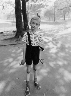 Diane Arbus: Child with Toy Hand Grenade in Central Park, New York City, 1962. S)