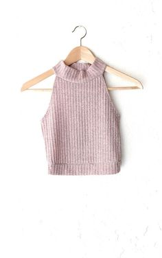 - Description - Size Guide Details: Super cute mock neck ribbed knit crop top in dusty pink . Form-fitting, tend to run on the smaller side & are more fitted. 70% Polyester, 22% Rayon. Made in USA. Si