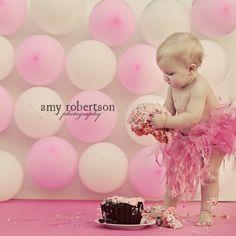 Cake smashing. Love the balloon backdrop