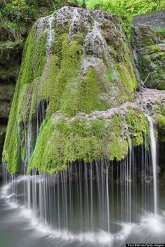 The water on this waterfall in Romania rolls off of a green carpet of moss that covers the rock formation — which results in a magically soft display, much unlike a roaring waterfalls. Who knew Mother Nature had so many tricks up her sleeve? Beautiful Waterfalls, Beautiful Landscapes, Cascade Falls, Waterfall Photo, Nature Landscape, Landscape Photos, Photos Voyages, Natural Wonders, Belle Photo